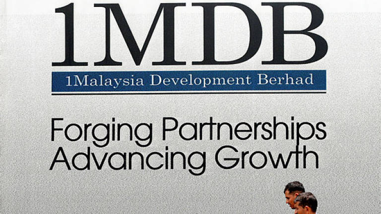 Singapore central bank says it made timely, relevant, adequate disclosures on 1MDB