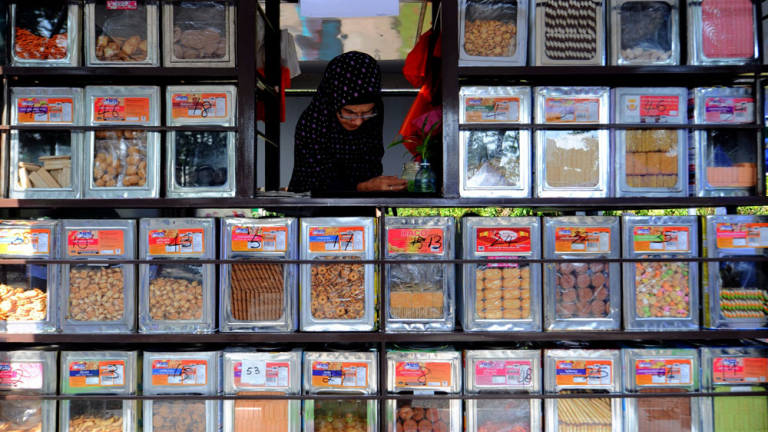 A biscuits seller at her booth during the launching of the Bazaar Program at the Memorial Tun Abdul Razak in Kuala Lumpur.