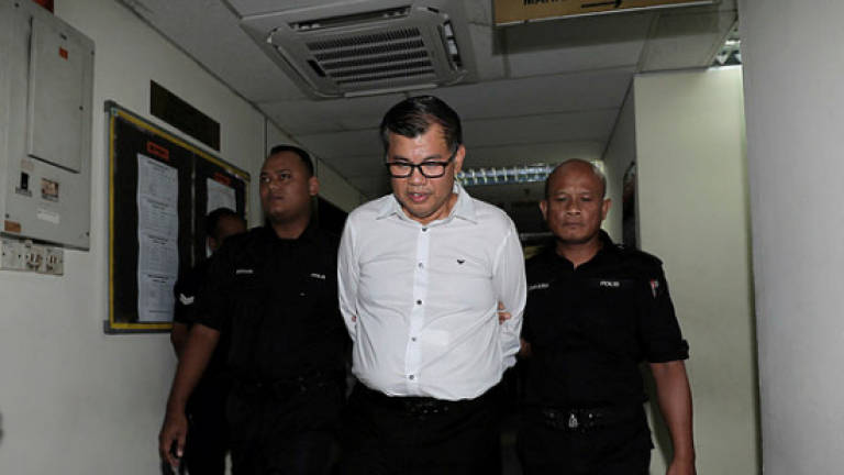 MBI founder charged with financial crimes, faces RM5m fine