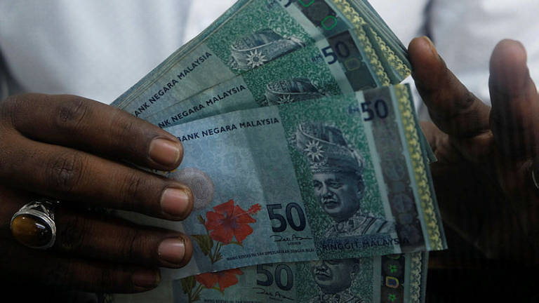 Ringgit lower against US dollar in early trading