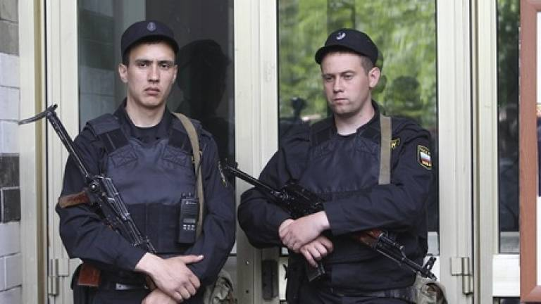 Russian police raid dozens of opposition offices, homes