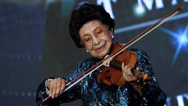 Siti Hasmah celebrates 93rd birthday playing violin for noble cause