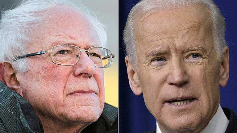 Late to 2020 party, Biden and Sanders bide their time