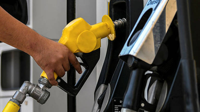 Prices of RON95 & diesel remain while RON97 increases 2 sen