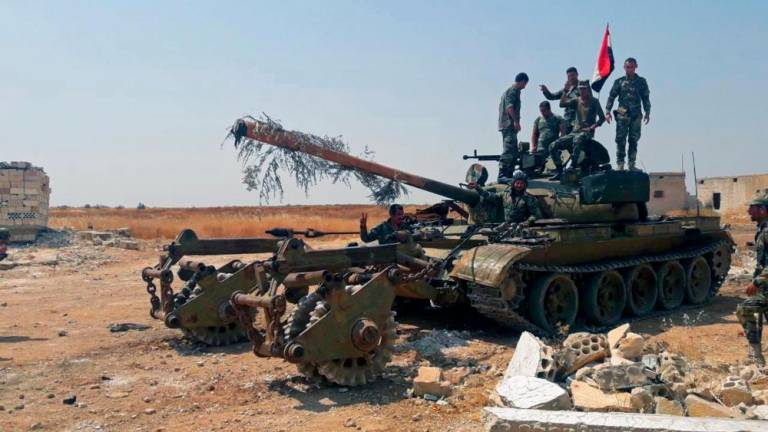 Syria regime forces inch closer to key jihadist-held town: Monitor