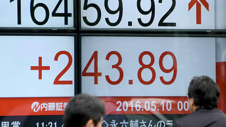 Tokyo stocks open higher with eyes on BoJ meet