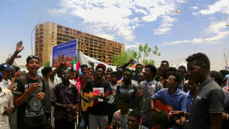 Sudan's Bashir moved to prison as protesters rally