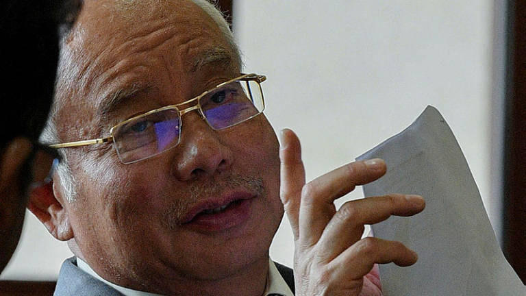 AmBank penalised for failing to report suspicious transactions in Najib's accounts: BNM Manager