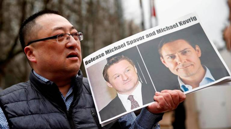China says detained Canadians treated in 'civilised way'