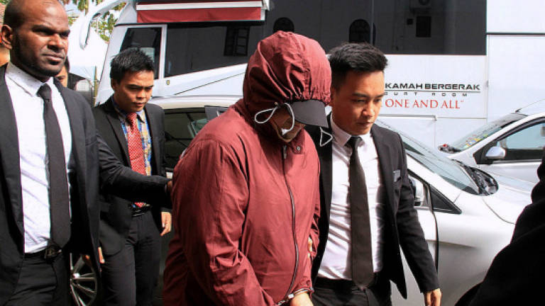 Former SWD deputy director pleads not guilty to 146 counts of money laundering, involving more than RM32m