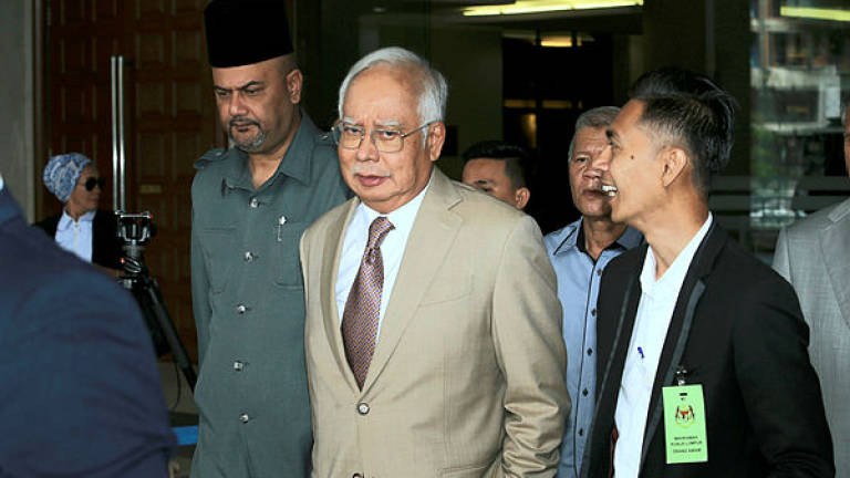 Najib's trial turns tense as defence disputes prosecution's re-examination style