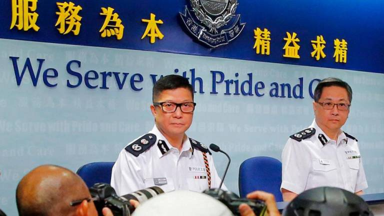 Hong Kong police to take both 'hard' and 'soft' approaches against protests - commissioner