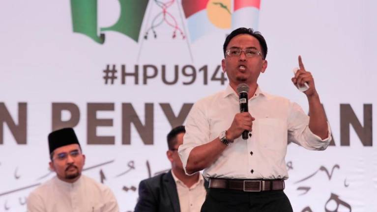 'Umno-PAS charter to honour the glory days of Islamic rule'