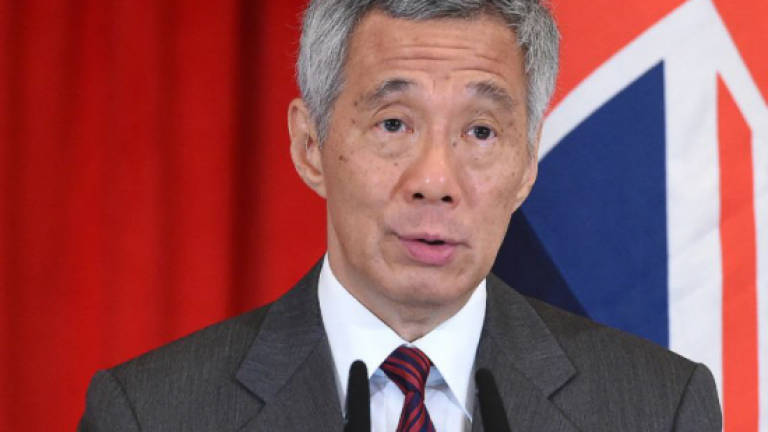 Singapore PM denies nepotism amid family feud in parliament speech