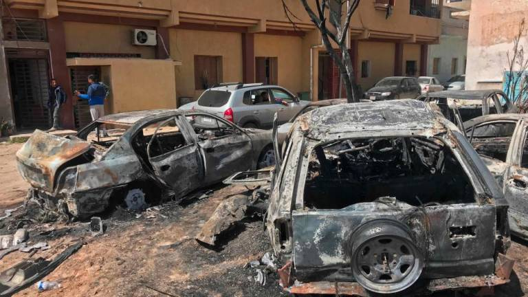 Two men stand at the scene of an overnight rocket attack, which no group claimed responsibility for so far, in the Libyan capital Tripoli on April 17, 2019. A number of rockets struck parts of Tripoli late yesterday after strongman Khalifa Haftar launched an offensive earlier this month to take the Libyan capital, witnesses and AFP journalists said. — AFP