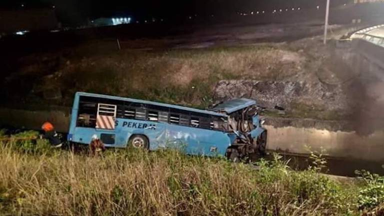 12 workers killed as bus plunges into drain (Updated)