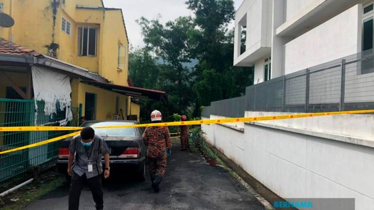 Officers from the Fire and Rescue Department at Taman Kelab Ukay, Bukit Antarabangsa following a landslide in the vicinity early today. — Bernama
