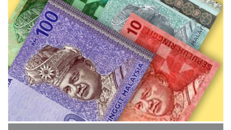 Ringgit closes easier against US dollar