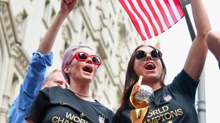 US World Cup winners feted with confetti, chants of 'equal pay'
