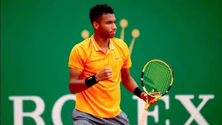 Teenage talent Auger-Aliassime records first ATP win on grass