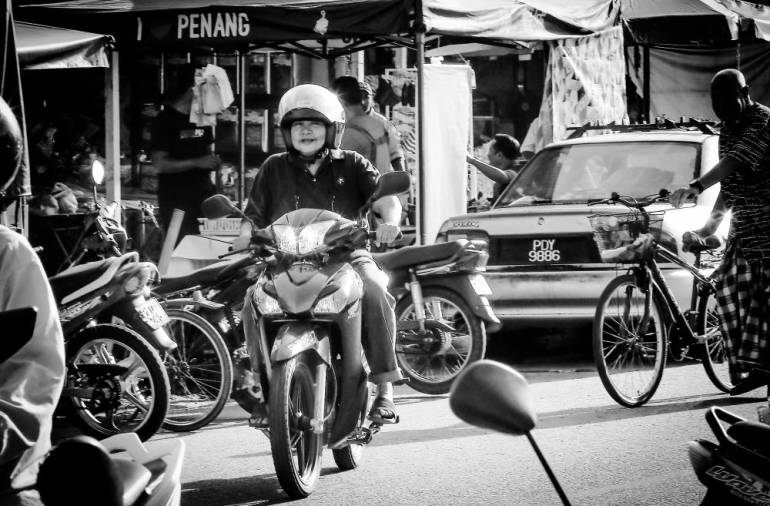 Azizah ride her motorcycle fromher house at Kampung Teluk to a wet market in Sungai Dua to buy daily supplies to cook for her disable sisters.
