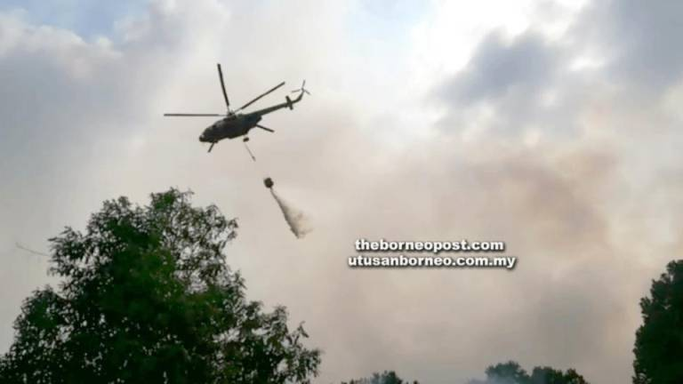Bomba starts water-bombing to contain peat fire