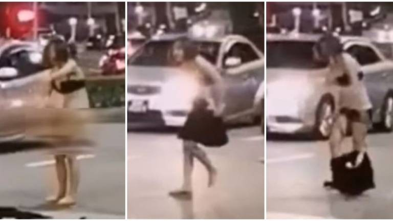 Singaporean woman strips off in public after row with taxi driver