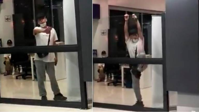 (Video) Tourist goes berserk after being told to wait for screening at Senai airport
