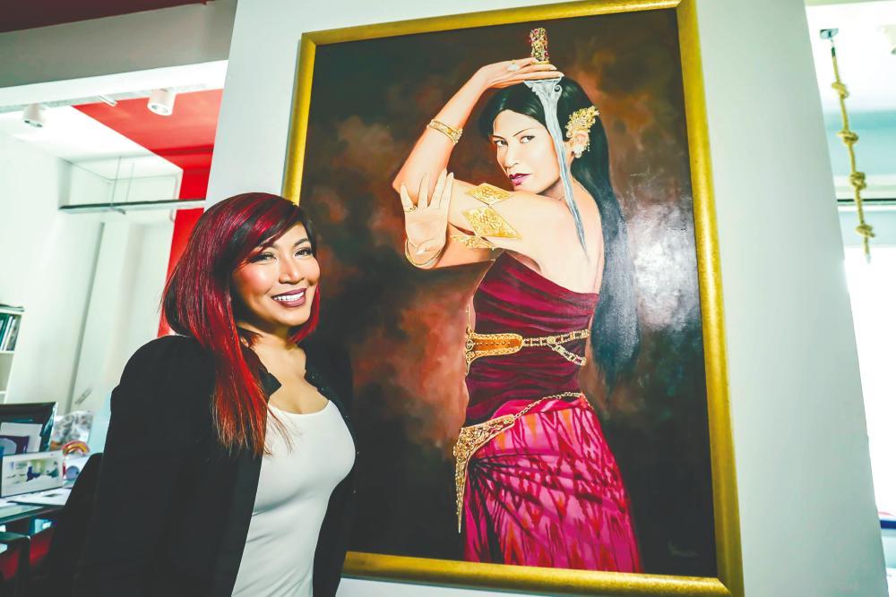 Tiara with her portrait of Puteri Gunung Ledang. - ADIB RAWI/THESUN