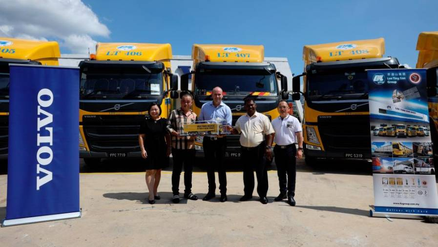 Presentation of Volvo FM scale model to mark the handover ceremony. Second and third from left LTS group CEO Lee Kah Chye and Volvo Malaysia managing director Mitch Peden.