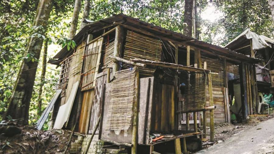 The dilapidated wooden hut which To'ki calls home. – ASHRAF SHAMSUL/THESUN