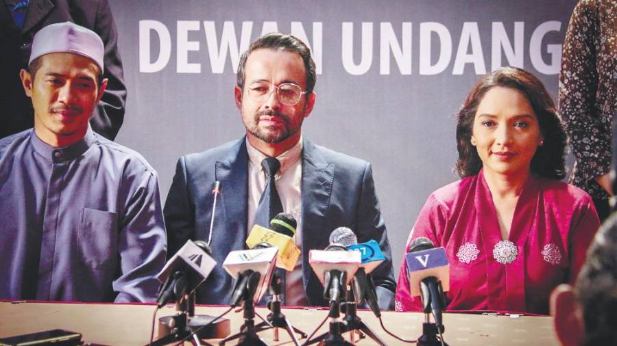 A scene from Daulat, a political thriller starring Tony Eusoff (centre) and Vanidah Imran (right). – Lacuna Pictures