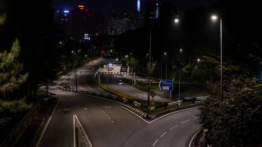 PLAYING SAFE ... Jalan Tun Razak in Kuala Lumpur was a picture of desolation on Wednesday night as people heed the conditional movement control order amid fears of escalating Covid cases recently. – ADIB RAWI YAHYA/THESUN