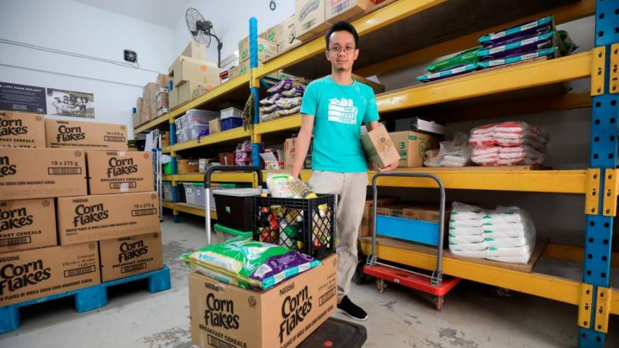 Syazwan with some of the food items donated to The Lost Food Project. – ASYRAF RASID/THESUN