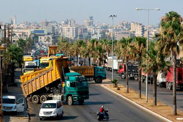 Truck drivers block roads in Beirut to protest fuel shortages due to Lebanon's deepening economic crisis. — AFP