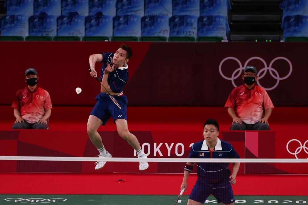 July 30, 2021, Aaron Chia of Malaysia and Soh Wooi Yik of Malaysia in action during the match against Li Junhui of China and Liu Yuchen of China. REUTERSPIX