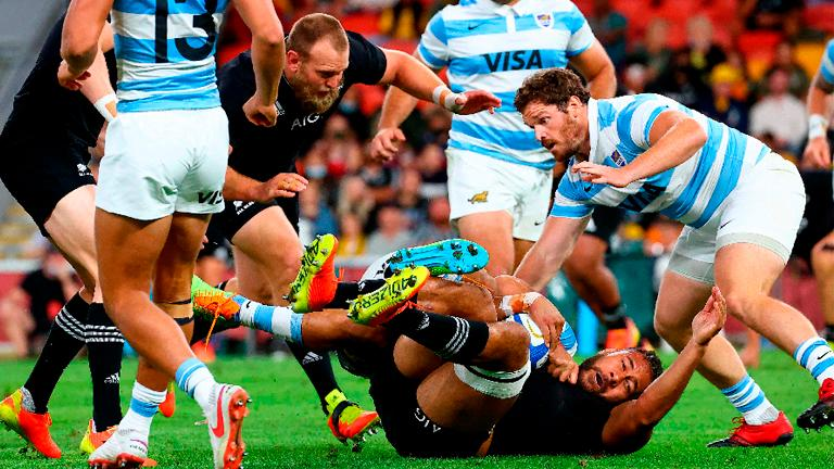 New Zealand's Patrick Tuipulotu (bottom) is tackled during the rugby Championship match against Argentina. – AFPPIX