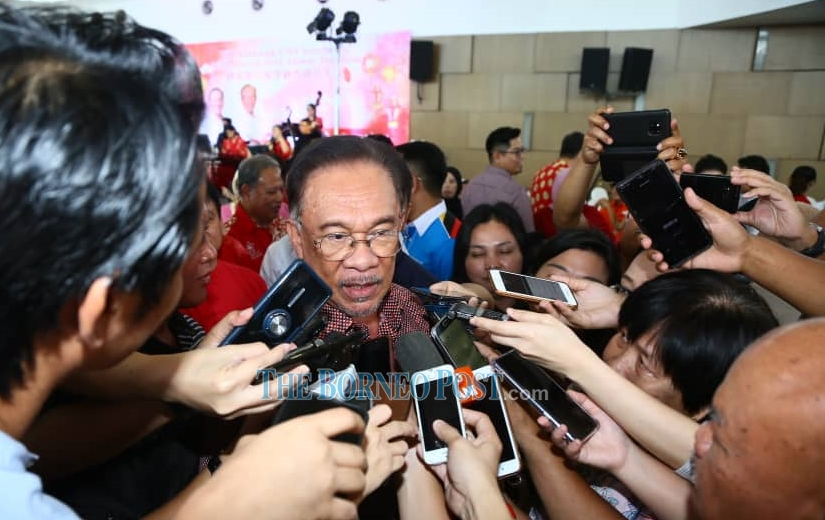 Anwar fields questions from reporters during the festive gathering. Photo by Muhammad Rais Sanusi