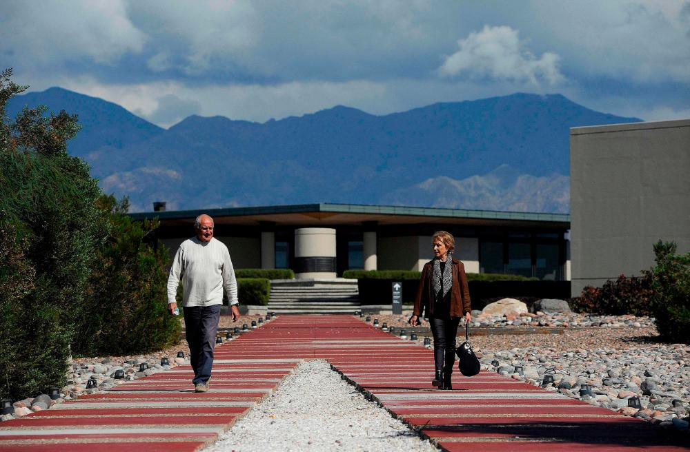 Architects Mario Yanzon (L) and Eliana Bormida walk posing for a picture at Alfa Crux, a winery in the Uco Valley, San Carlos Department, in the Argentine province of Mendoza, on April 1, 2021. –AFP