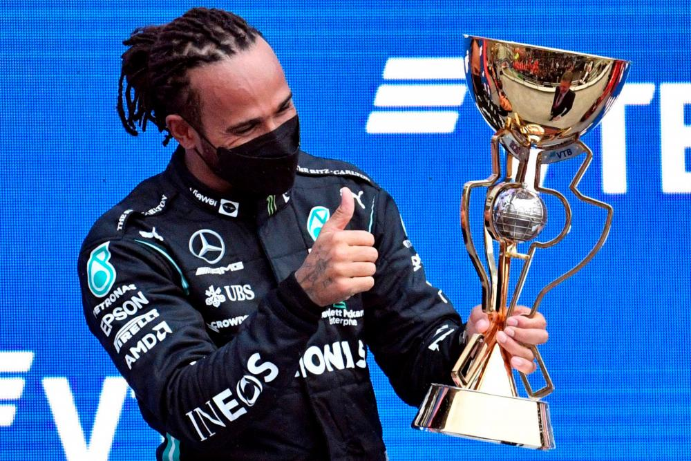 Mercedes' British driver Lewis Hamilton celebrates after winning the Formula One Russian Grand Prix at the Sochi Autodrom circuit in Sochi on September 26, 2021. AFPpix