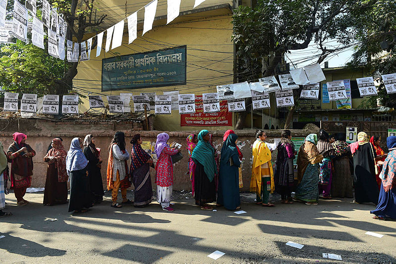 Bangladeshi voters wait in line outside a polling station in Dhaka on Dec 30, 2018. — AFP