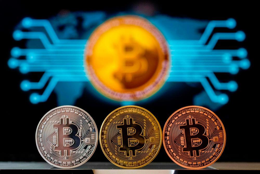 A visual representation of Bitcoin. – AFPPIX