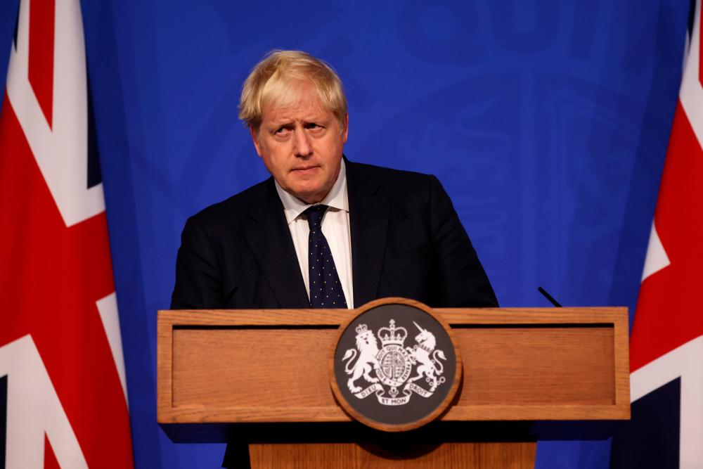 Britain's Prime Minister Boris Johnson looks on during a news conference on the coronavirus disease (Covid-19) in the Downing Street Briefing Room, London, Britain September 14, 2021. Dan Kitwood/Pool via REUTERSpix