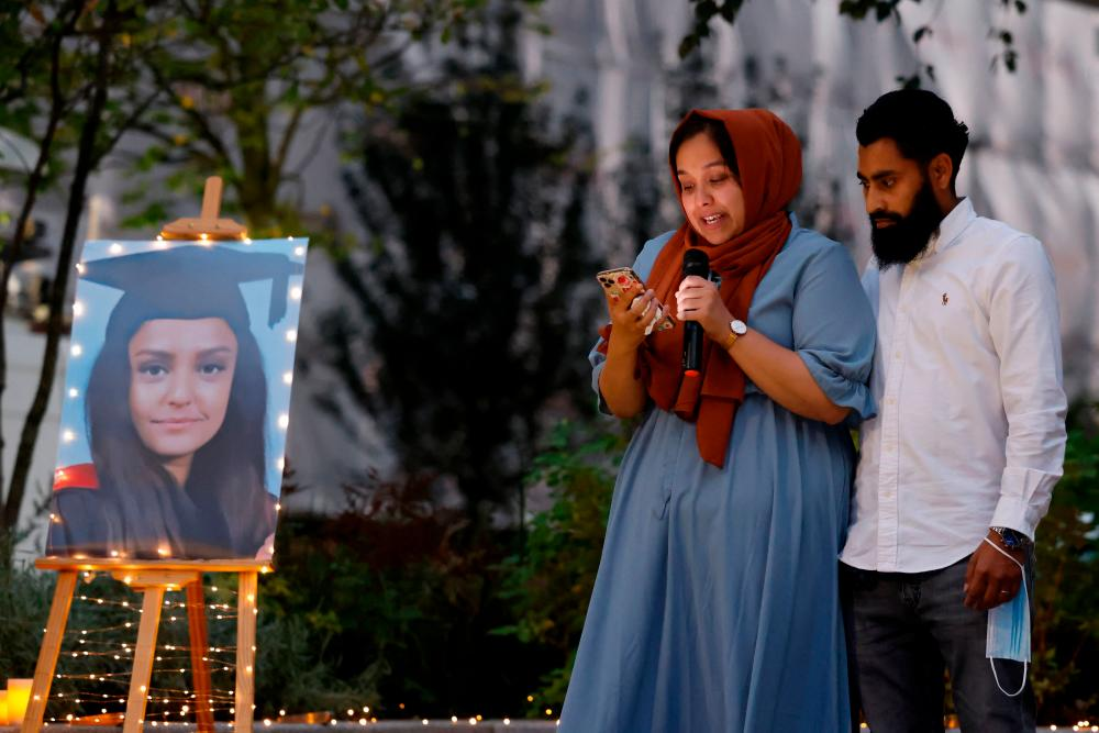 Jebina Nessa (L) pays tribute to her sister during a vigil for 28 year-old teacher Sabina Nessa, whose body was found near the Onespace community centre, at Pegler Square, Kidbrooke in south east London on September 24, 2021. AFPpix