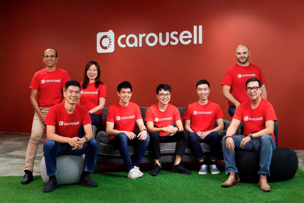 Seated from left: Carousell growth & strategy senior vice president JJ Chia, operations vice president Tan Su Lin, co-founders Quek, Marcus Tan, and Lucas Ngoo, and CCO Lewis Ng. (Far left, standing) Rakesh and (far right) chief technology officer Igor Volynskiy.