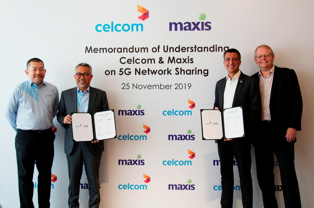 From left: Celcom Axiata Bhd chief strategy and value creation officer Muniff Kamaruddin, CEO Idham Nawawi, Maxis Bhd CEO Gokhan Ogut, and chief technology and information officer Morten Bangsgaard at the signing today.