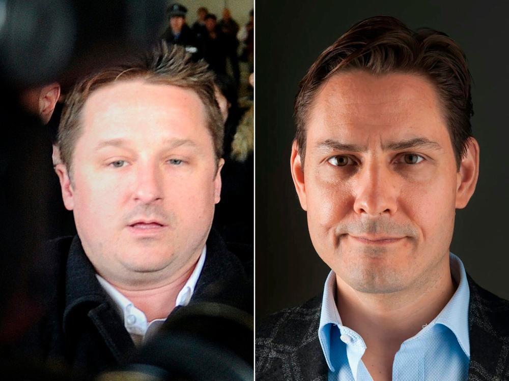 This combination of file pictures created on September 24, 2021 shows Canadian businessman Michael Spavor (L) and former Canadian diplomat Michael Kovrig. AFPpix