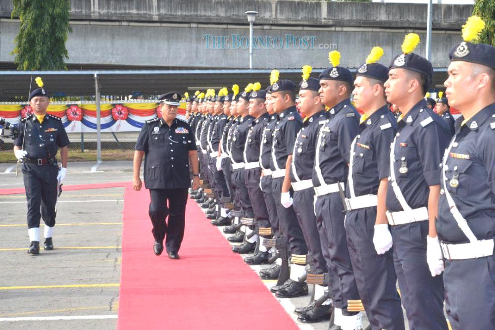 Omar inspecting members of the police force during his working visit to IPD Kota Kinabalu. — Borneo Post
