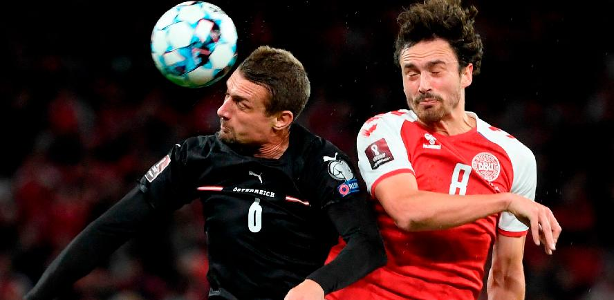 Austria's Stefan Ilsanker (left) and Denmark's Thomas Delaney vie for the ball during the FIFA World Cup Qatar 2022 qualification Group F match. – AFPPIX