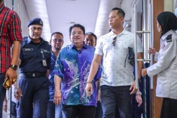 Tengku Adnan pleads not guilty to two counts of receiving RM3m bribe. — Sunpix by Adib Rawi Yahya